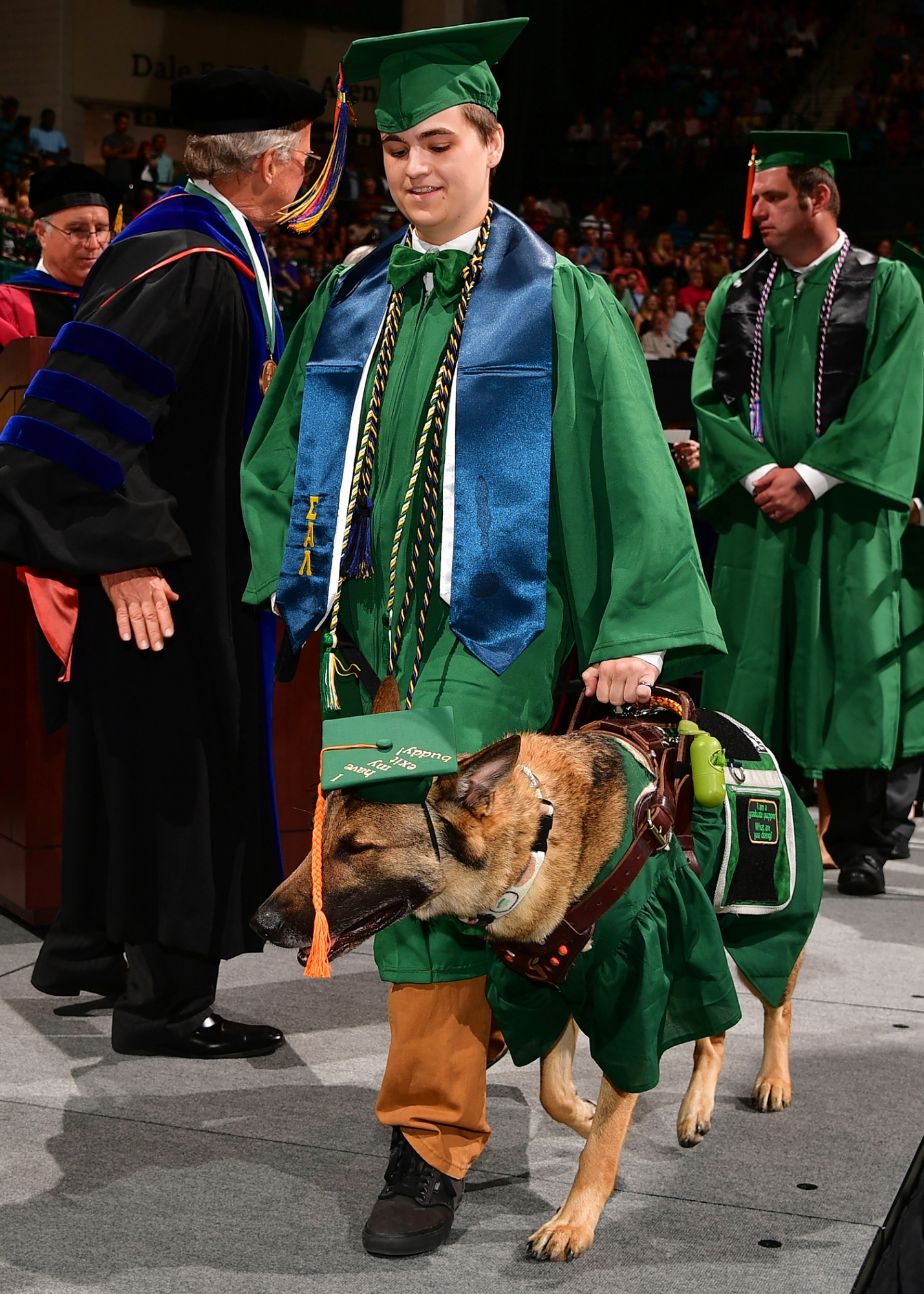 Graduate with service dog at UNC Charlotte Spring 2018 Commencement